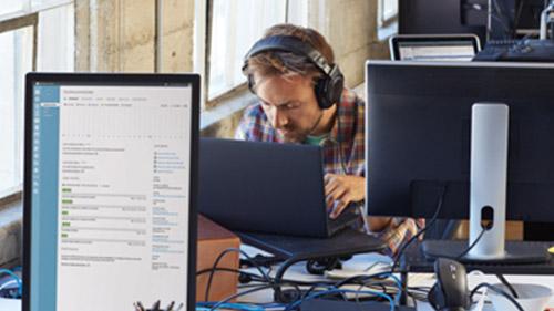 Man wearing headphones working on computer