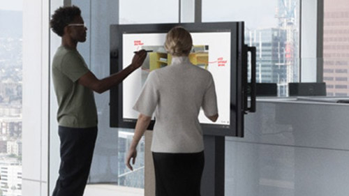Man and woman working on Surface Hub