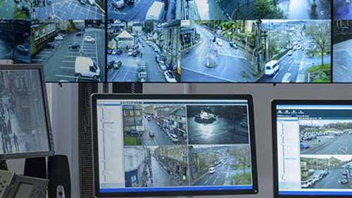 Multiple monitors with security feeds displayed