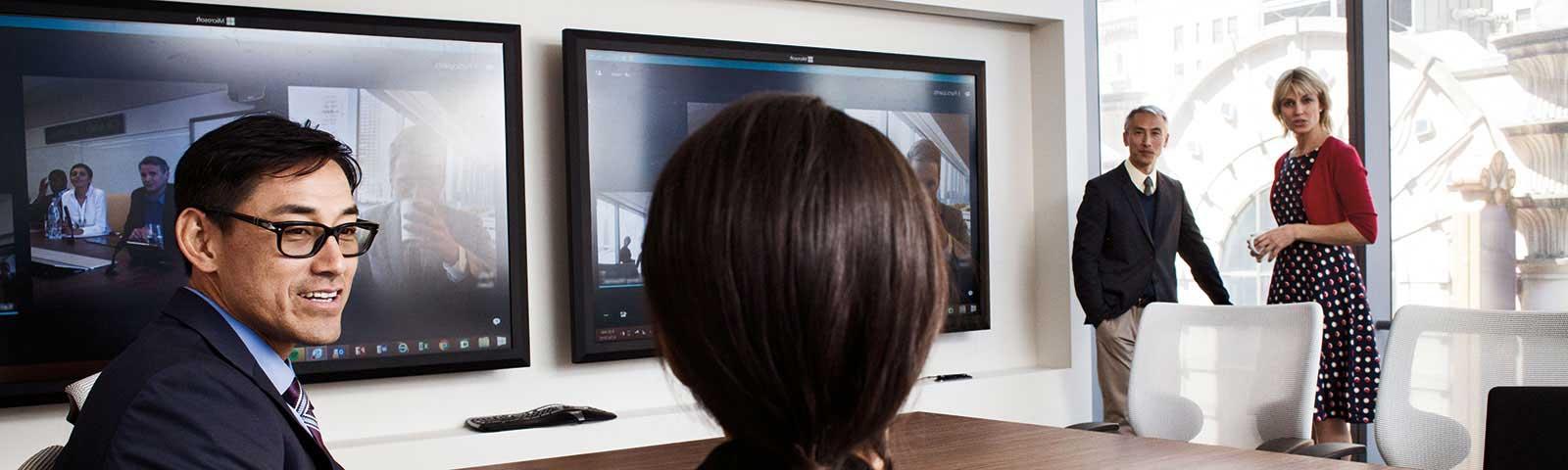 Colleagues having meeting through Skype
