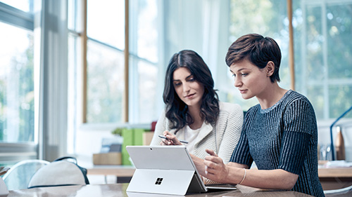 Two businesswomen working on a laptop
