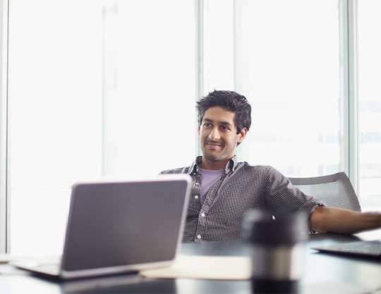 Man sitting in a meeting and smiling