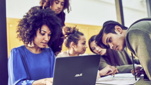 Image of a group of students around a computer
