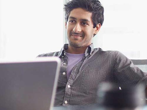Man posing for photo near window