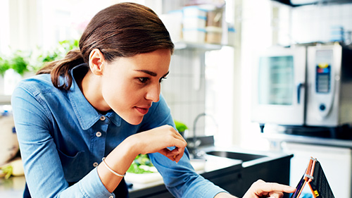 Woman scrolling through tablet