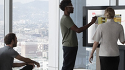 Man presenting at meeting with Surface Hub
