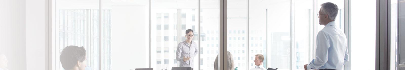 Man talks to his peers in a boardroom