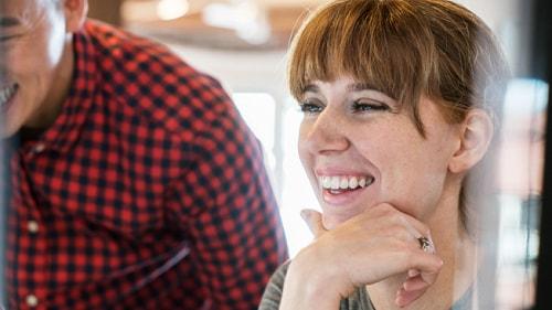 Smiling woman looking at computer