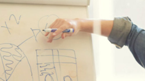 Image of man drawing on whiteboard