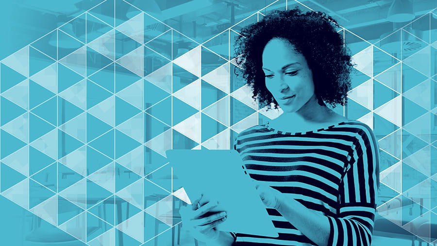 Woman working on tablet in office space, light blue overlay over image