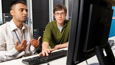 Two people use .net at work