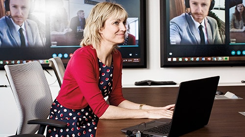 Woman at desk during a Skype business meeting