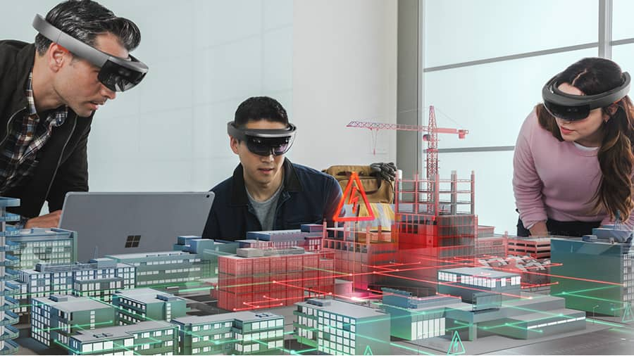 Two men and woman using VR to assist with a project