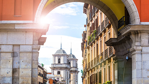 Image of old buildings with sun shining in Spain