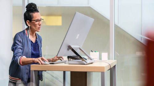 Woman using Surface desktop