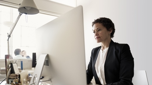 Woman working at desktop
