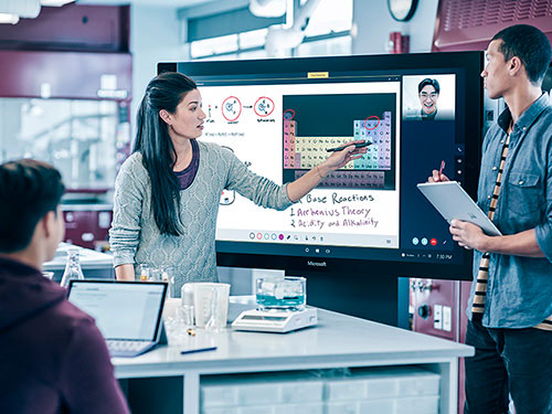 Colleagues during meeting working on Surface Hub and Surface tablets
