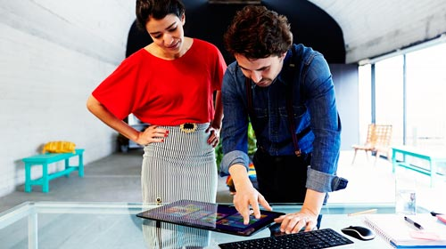 Man and woman working on tablet