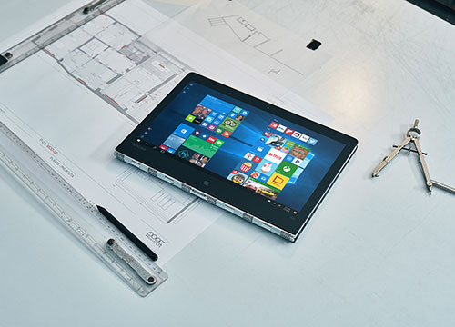 A tablet laying on a desk.