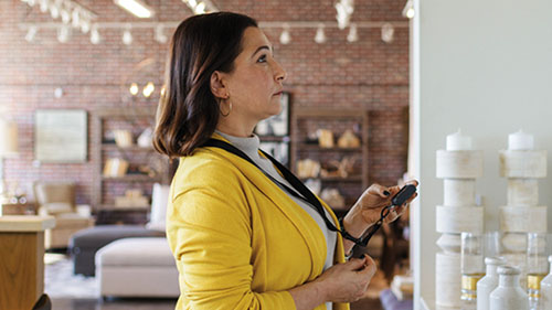Woman in store using device