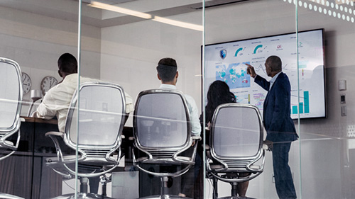 Team analyzing data in conference room