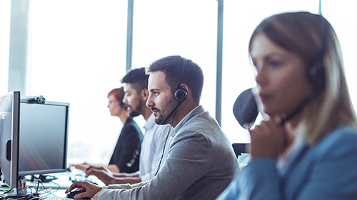 Group of employees working with headsets on