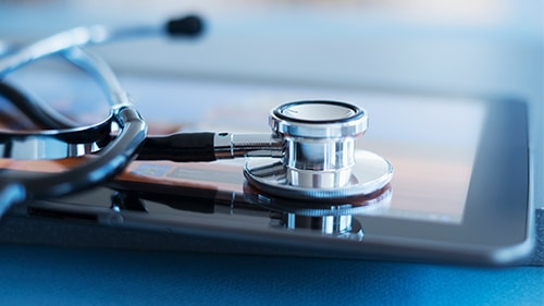 Stethoscope laying on tablet