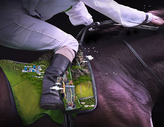 Horse and jockey with city on saddle