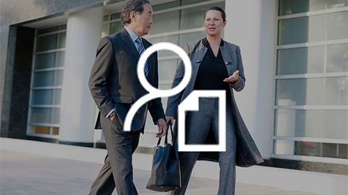 Two colleagues walking, with person and resume icon