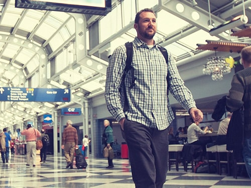 Man walking down terminal at train station