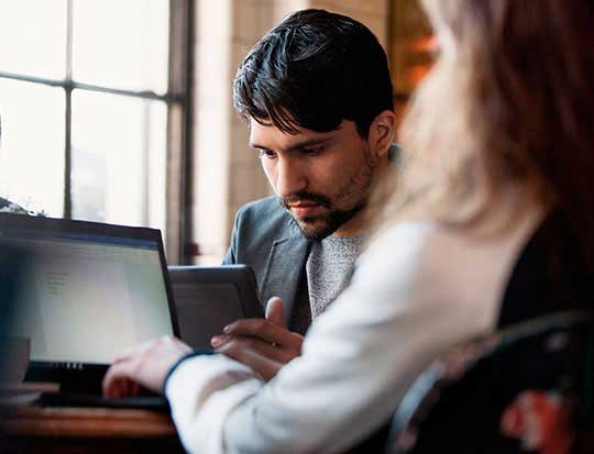 Image of man working on surface during a meeting