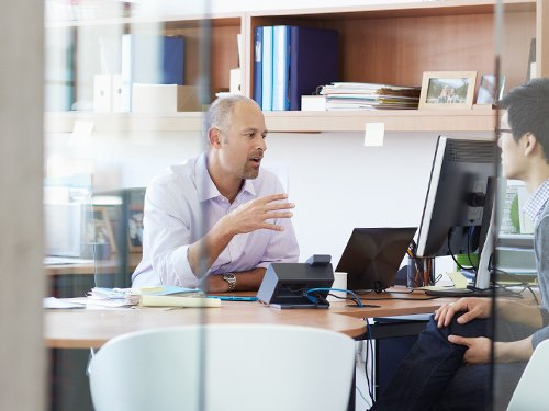 Two men meeting in office for meeting