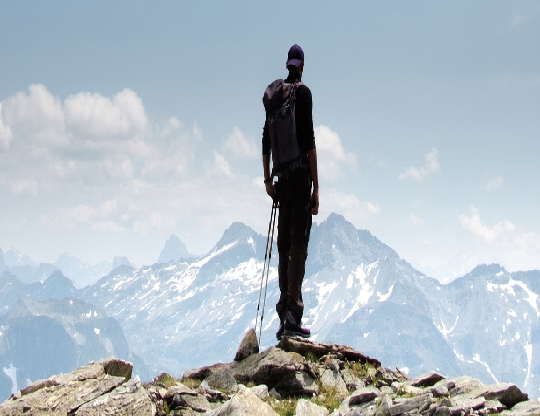 A man looking at the mountains