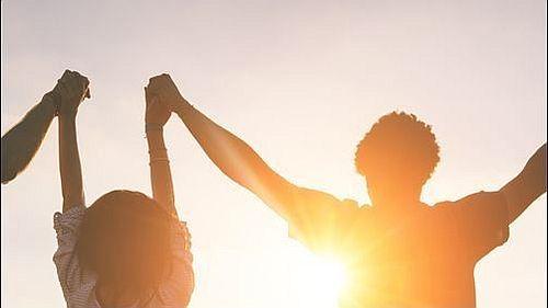 Teens holding hands