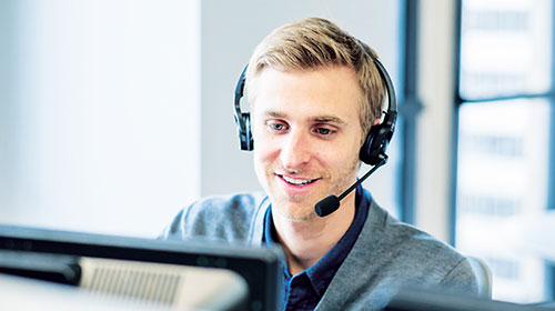 Call center employee talking into a headset.
