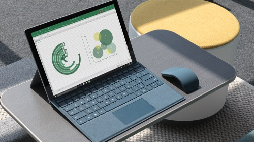 Surface Pro 5 on tray with Surface Arc Mouse